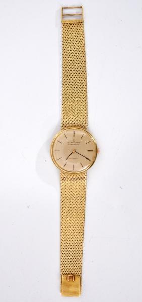 f87afb2b395 UNIVERSAL GENEVE - Relógio de ouro com pulseira fixada na caixa